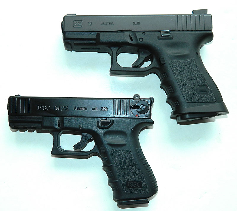 With the exception of the manual safety added due to import restrictions, ISSC M22 (bottom) looks like and mimics the feel of the Glock 19.