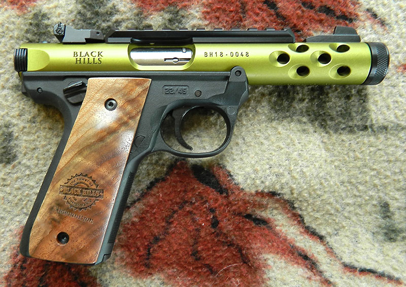 Black Hills Commemorative Ruger 22/45 feels and points like a 1911 and its safety, magazine release, and slide release all operate in the same fashion.