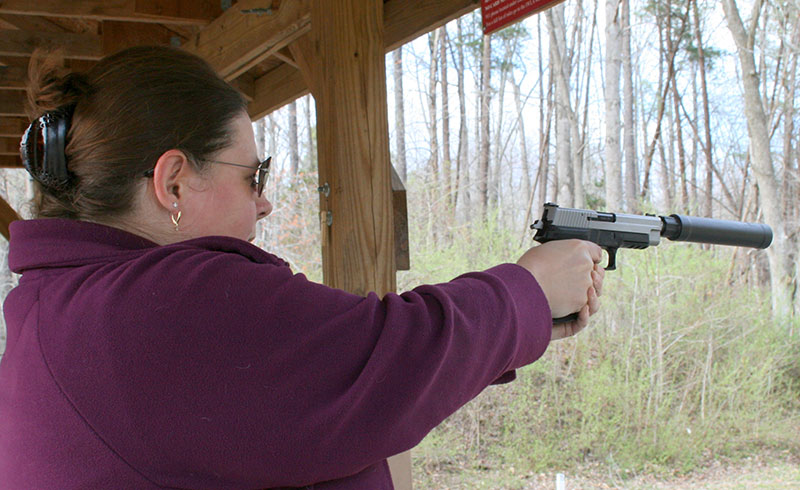 "Members of author's shooting club enjoyed launching ""quiet"" bullets with SIG Sauer P226 pistol. They felt less intimidated when muzzle blast was reduced."