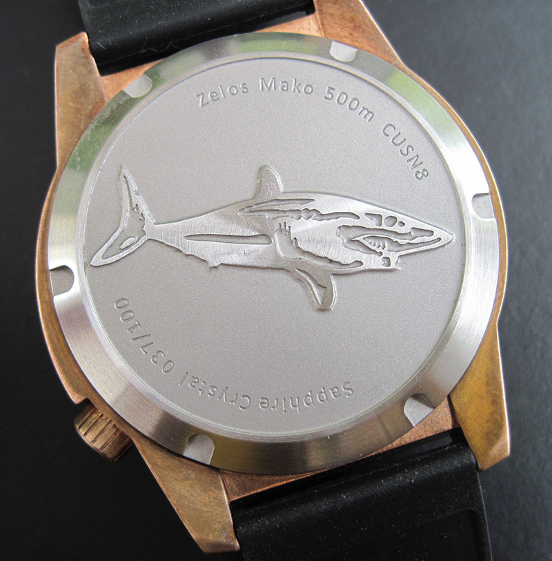 Back of watch has raised Mako shark.