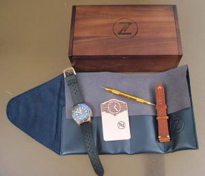 Zelos Mako Bronze Diver watch includes leather strap, strap-changing tool, warranty card, leather watch roll, and wooden box.