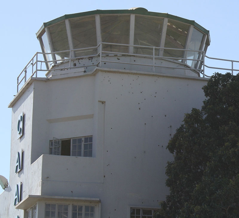 First documented operational use of NFDD was by Israeli commandos during raid at Entebbe in 1976. Bullet holes from raid are visible in old terminal building of Entebbe International Airport. Photo: U.S. Army photo by Lt. Col. David Konop / Released