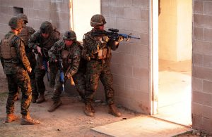 Marines with 2nd Battalion, 1st Marines prepare to clear building after throwing flashbang at Camp Pendleton, California in 2014. Photo: U.S. Marine Corps photo by Lance Cpl. Joshua Murray / Released