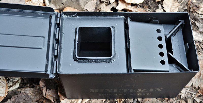 Once everything is packed away inside, lid of Minuteman Rocket Stove can be placed on top. Even with burner placed inside burn chamber, there is plenty of room to store next fire's tinder bundle.