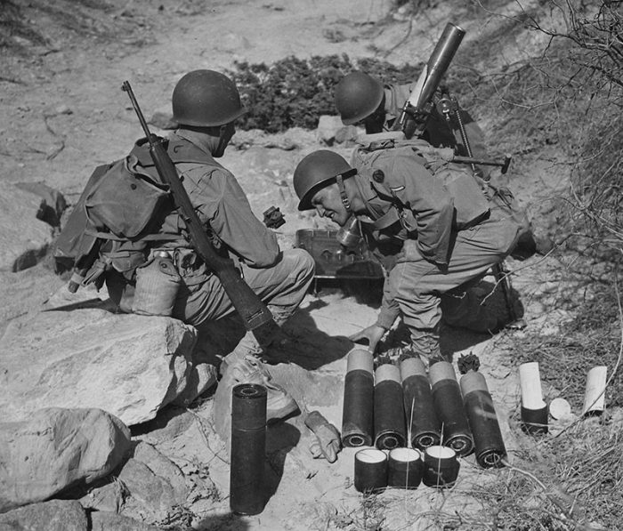 M1 Carbine was designed to arm support troops like these mortar men, for whom direct contact with the enemy was a secondary concern.