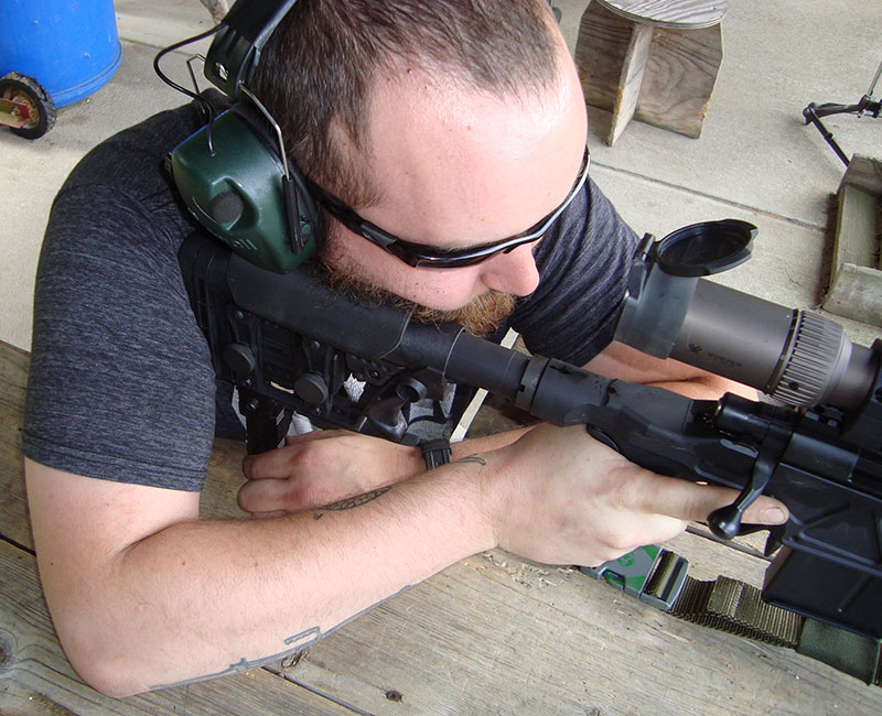Will S. fine-adjusts CTK Precision rear monopod, easing reticle into perfect alignment with target.