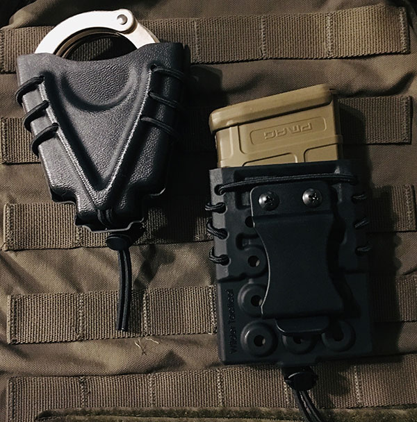 Clever use of shock cord for providing retention and robust quick-detach clip. Multiple holes on the back permit stacking pouches.