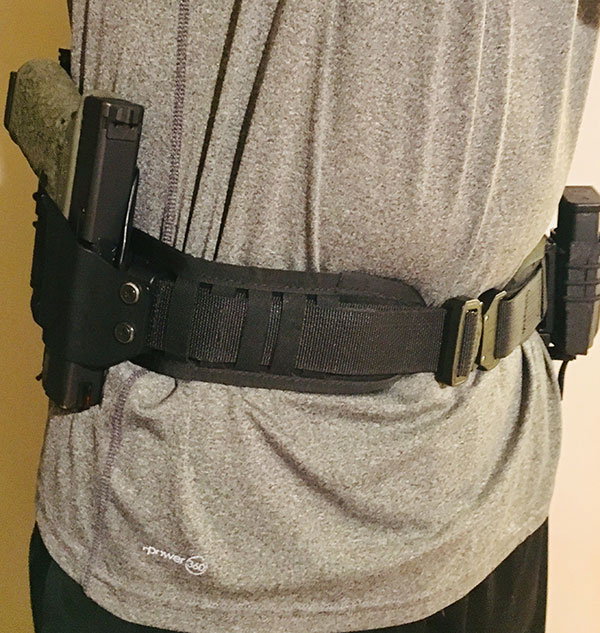 Minimalist Belt Pad worn over gym shorts and t-shirt. It can be quickly donned and makes it easy to keep defensive tools in close proximity.