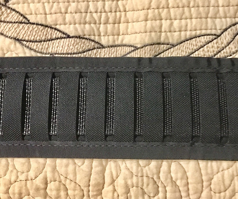 Wilder Tactical Minimalist Belt Pad uses vertical slots instead of horizontal MOLLE slots, making use of conventional holsters and pouches possible.
