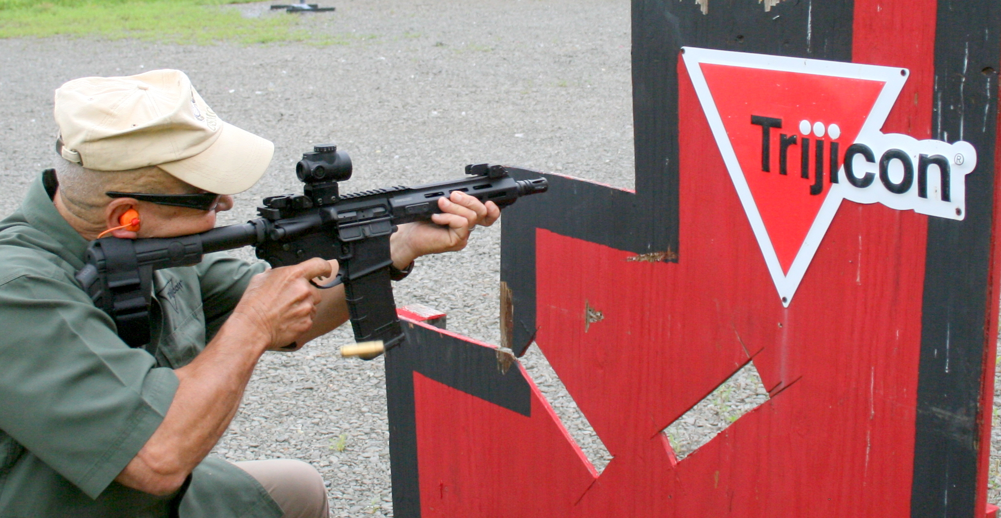 USMC Colonel (Retired) Frank Martello, VP at Trijicon, spanks steel at 100 yards with highly accurate and rugged MRO red-dot sight.