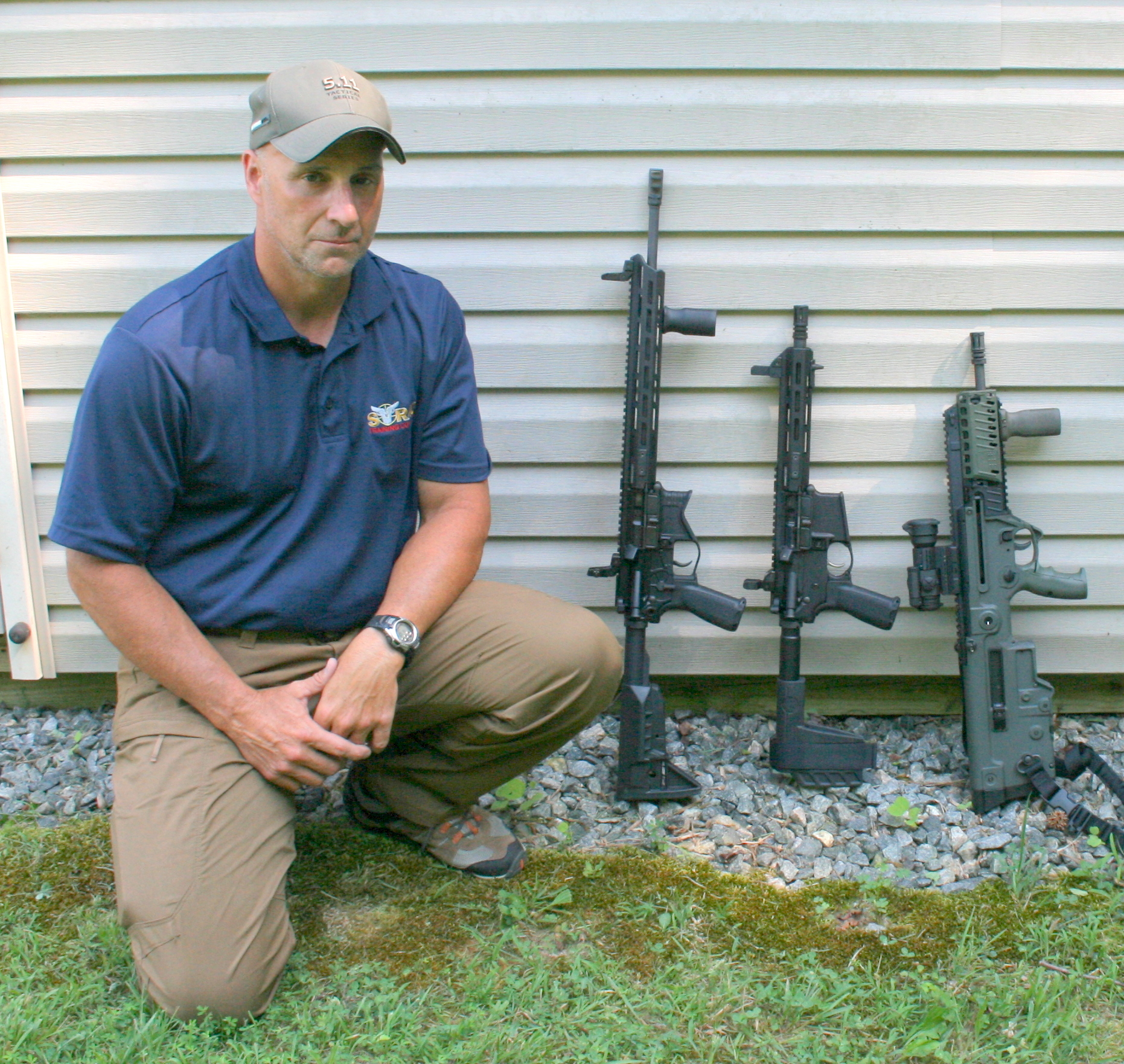 Former U.S. Air Marshal Ken Trice shows overall length differences among (left to right) 16-inch barrel SAINT AR rifle, nine-inch barrel SAINT .300 BLK pistol, and 16.5-inch barrel Tavor X95 Bullpup rifle. Bullpup would solve subcompact rifle's loss of muzzle velocity, reduction in engagement range, and terminal effectiveness while retaining high degree of maneuverability at close quarters.