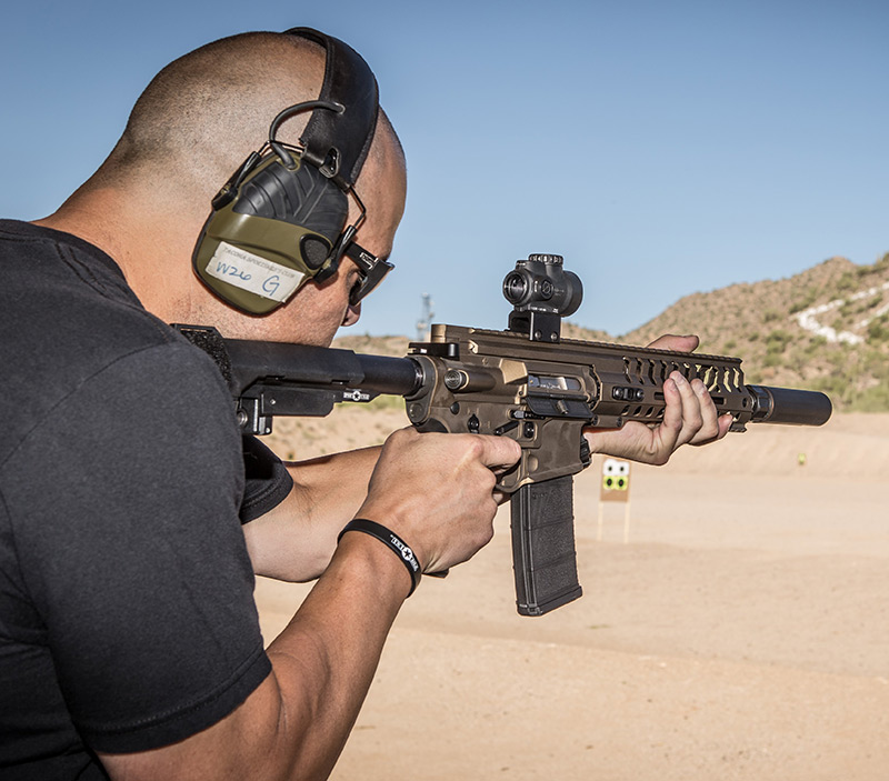 Will Milazzo of POF-USA fires P415 Edge Pistol with Dead Air Armament Sandman-K suppressor at Rio Salado Sportsmans Club in Mesa, Arizona during author's evaluation. P415 was tested both with and without suppressor.