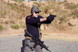 Transitioning to the pistol should be based on the distance to the threat, not the condition of the rifle.