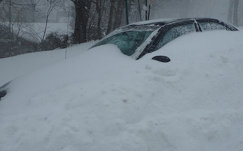 Abandoned car sits in wooded area during a blizzard in New Jersey. Luckily in this case, nobody was hurt and the motorists were able to walk away.
