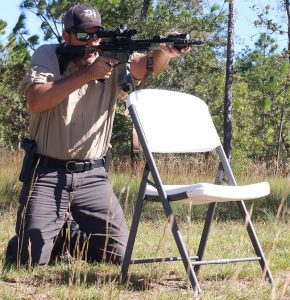 First position is High Kneeling shooting over simulated cover.