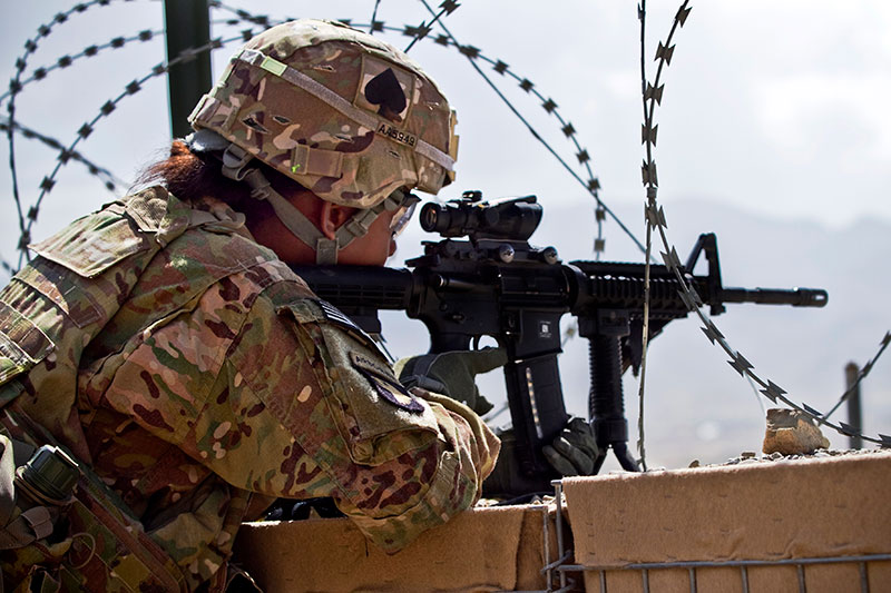 Member of 4th Bde. Combat Team, 101st Airborne Division firing issue M4 with ACOG mounted. Photo: U.S. Army