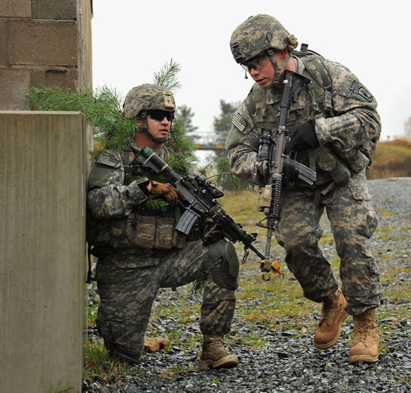 Members of 173rd Airborne with M4s mounting Trijicon ACOGs. Photo: U.S. Army