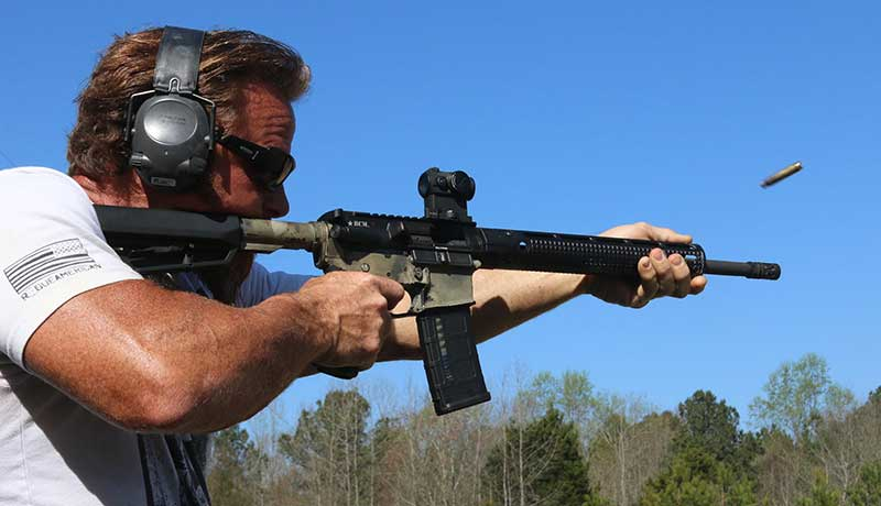 Pat MacNamara firing rifle a year and about 3,500 rounds after its initial lubrication.