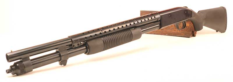 Mossberg 590 sports a bit more testosterone than Model 500. With extended magazine, heat shield, and bayonet lug, 590 cuts a dashing figure and still accepts FLEX TLS components.