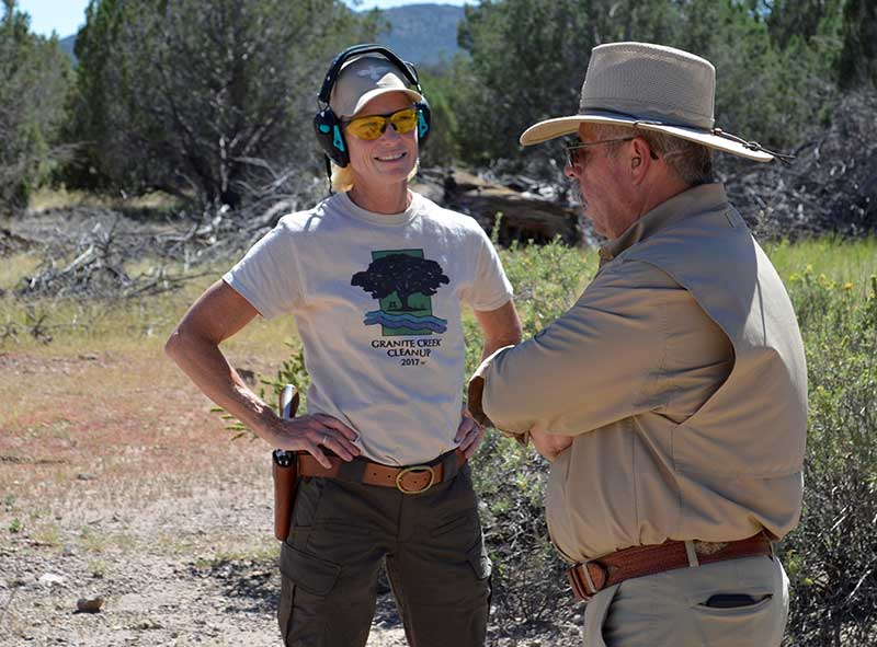 JoAnne Conn from Gunsite chapter of Well-Armed Woman gets a few tips from Rangemaster Ed Head before going through the Scrambler.