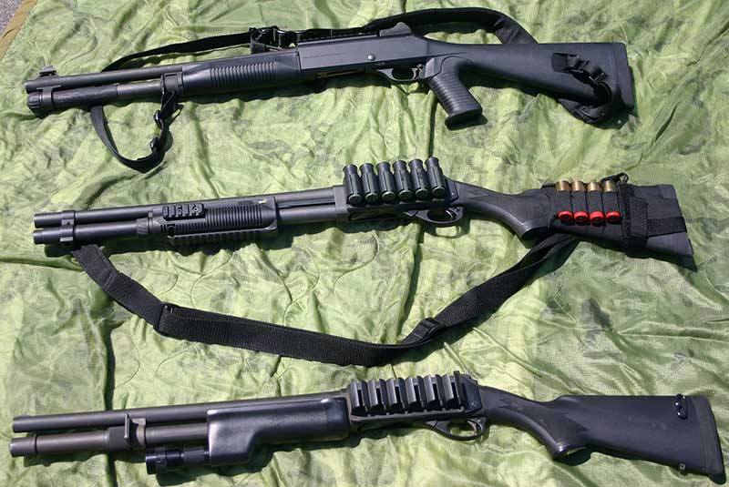 Three good tactical shotguns: Benelli M4 semi-auto and two Remington 870s. Bottom gun is custom build from Scattergun Technologies with ghost-ring sights and mounted light.