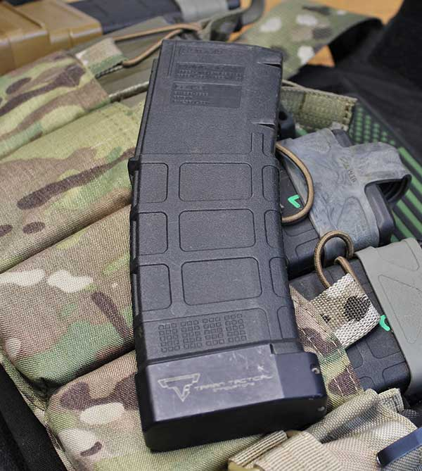 Taran Tactical Innovations Magazine Extension adds five rounds to standard PMAG and six rounds to 40-round PMAG.
