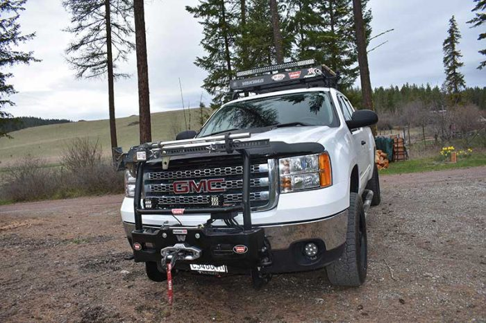 Warn Trans4mer mount holds the winch, lights, and Hi-Lift jack.