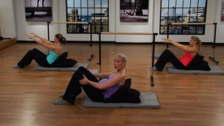 Check out this prenatal barre workout featuring gentle and safe moves. We'll challenge the thighs, strengthen the abdominals and work with free weights.