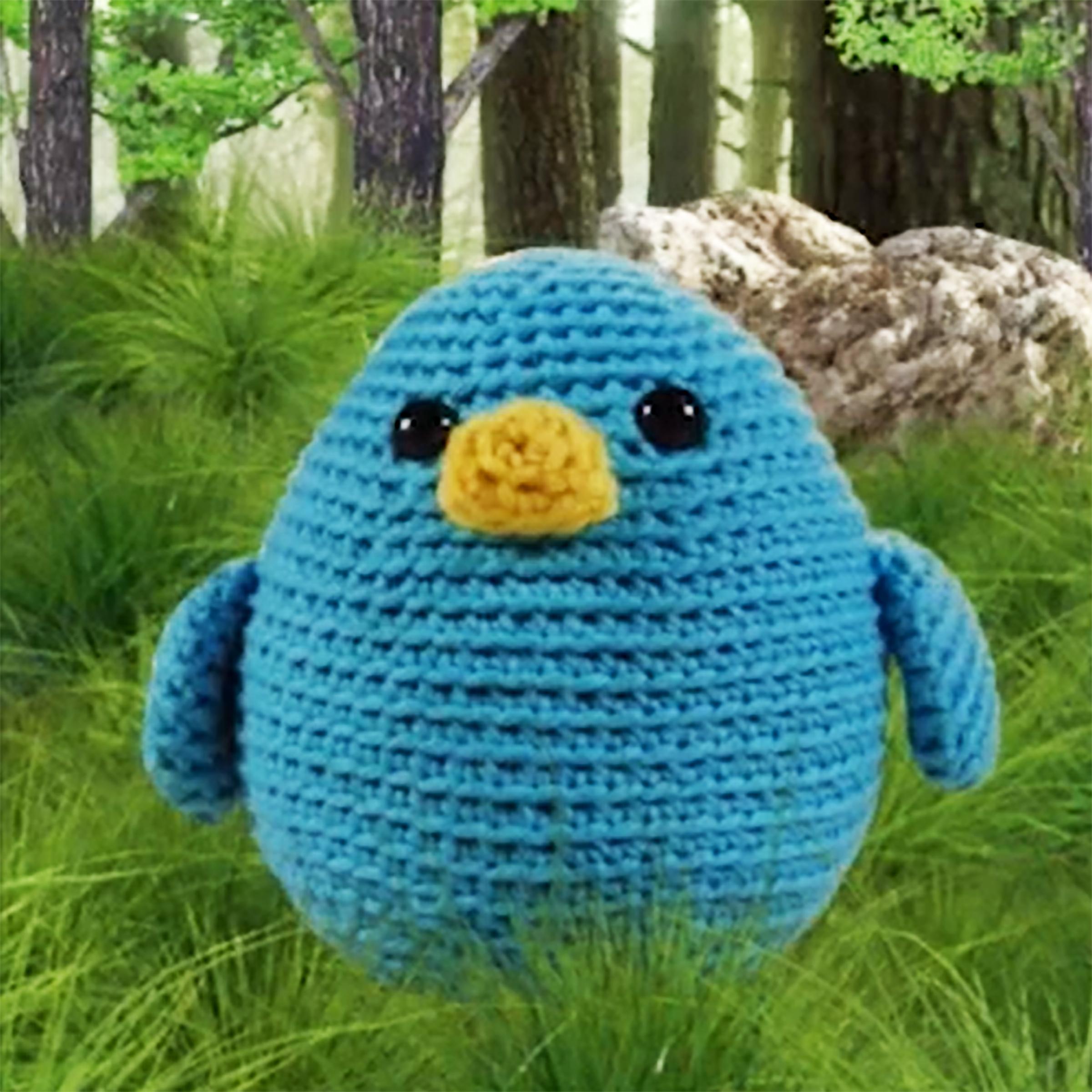 small blue crocheted bird with yellow beak