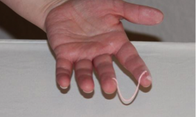 Handing Holding Icing to Demonstrate Consistency