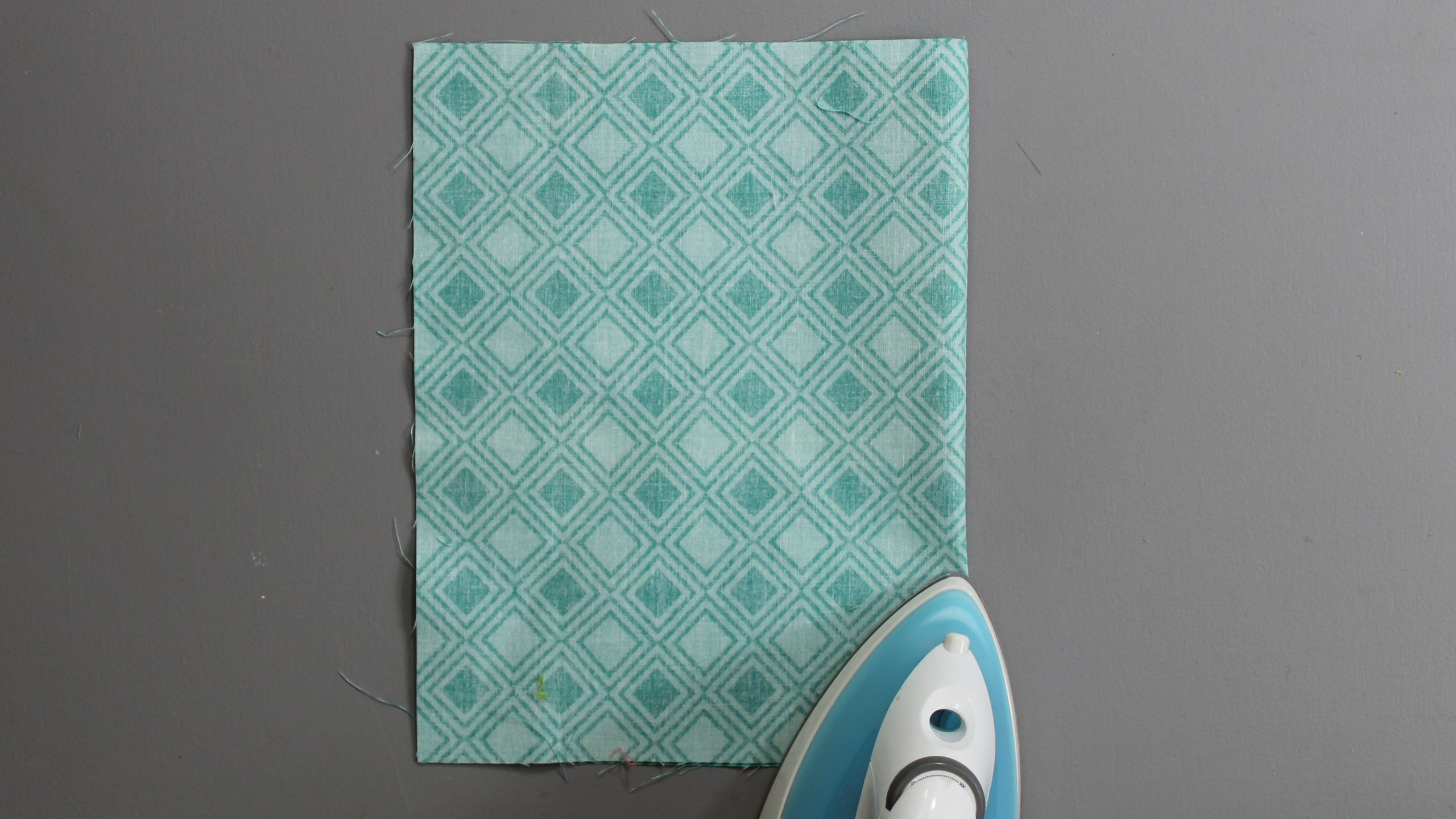 Ironing the fold line of the fabric