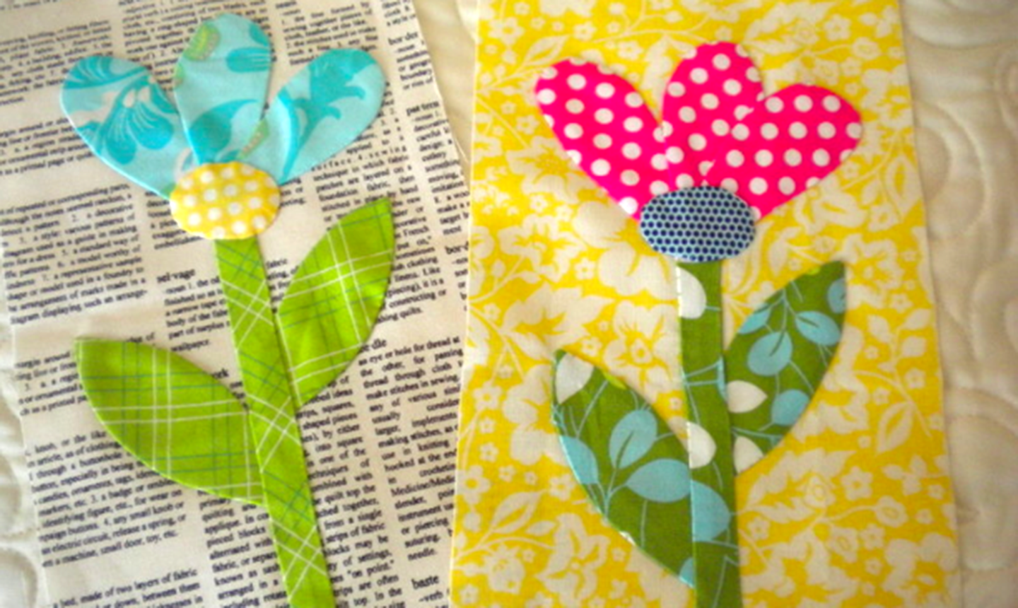 hand applique flowers on newspaper