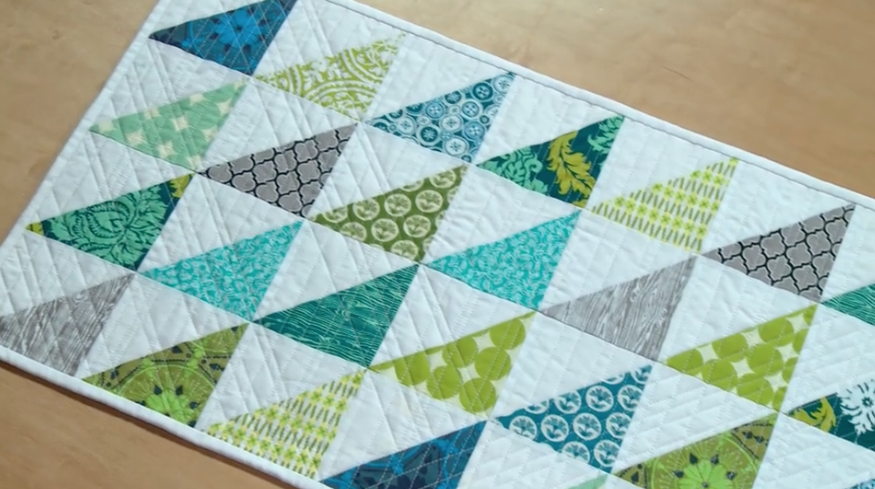 blue white and teal quilted table runner