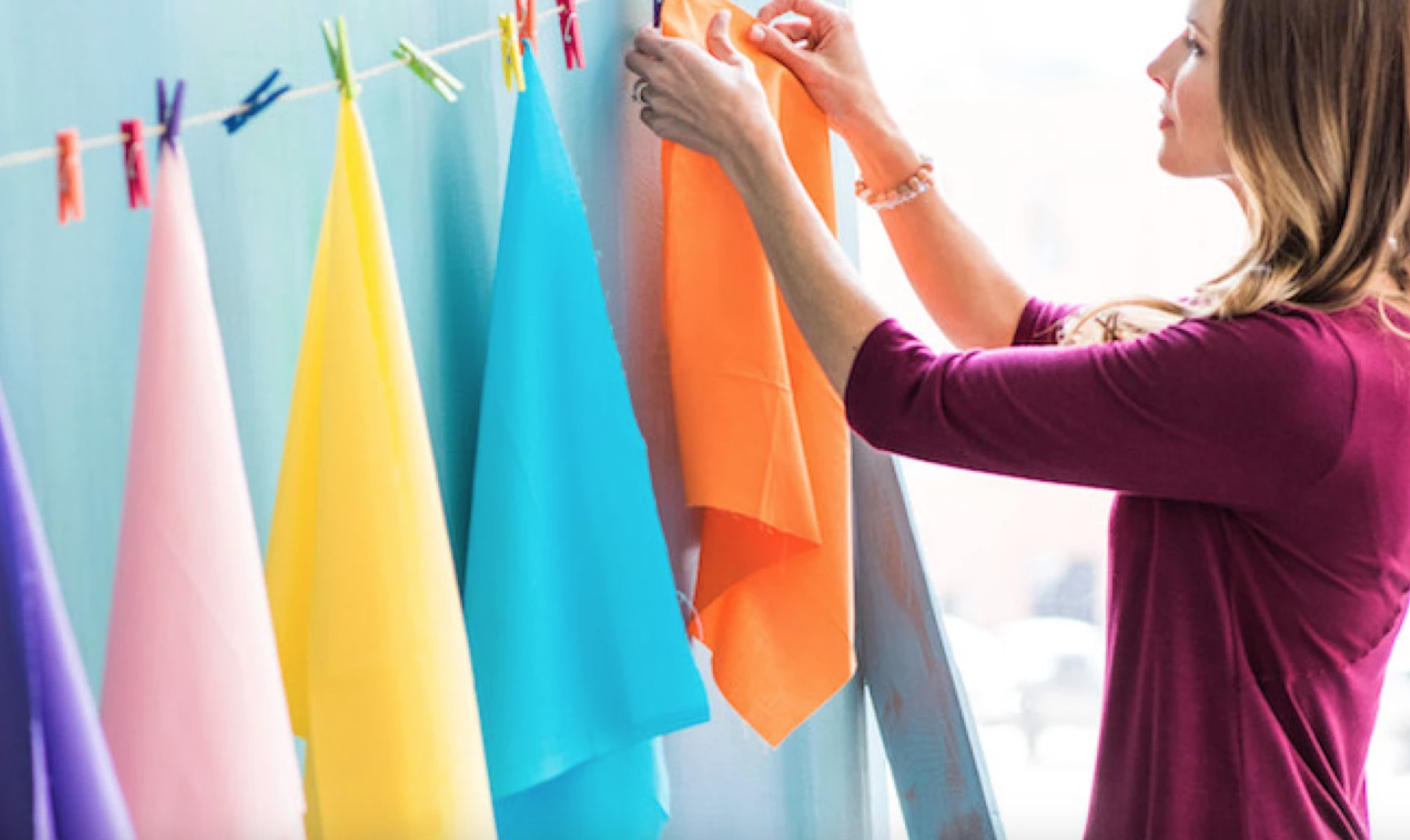 woman drying fabric