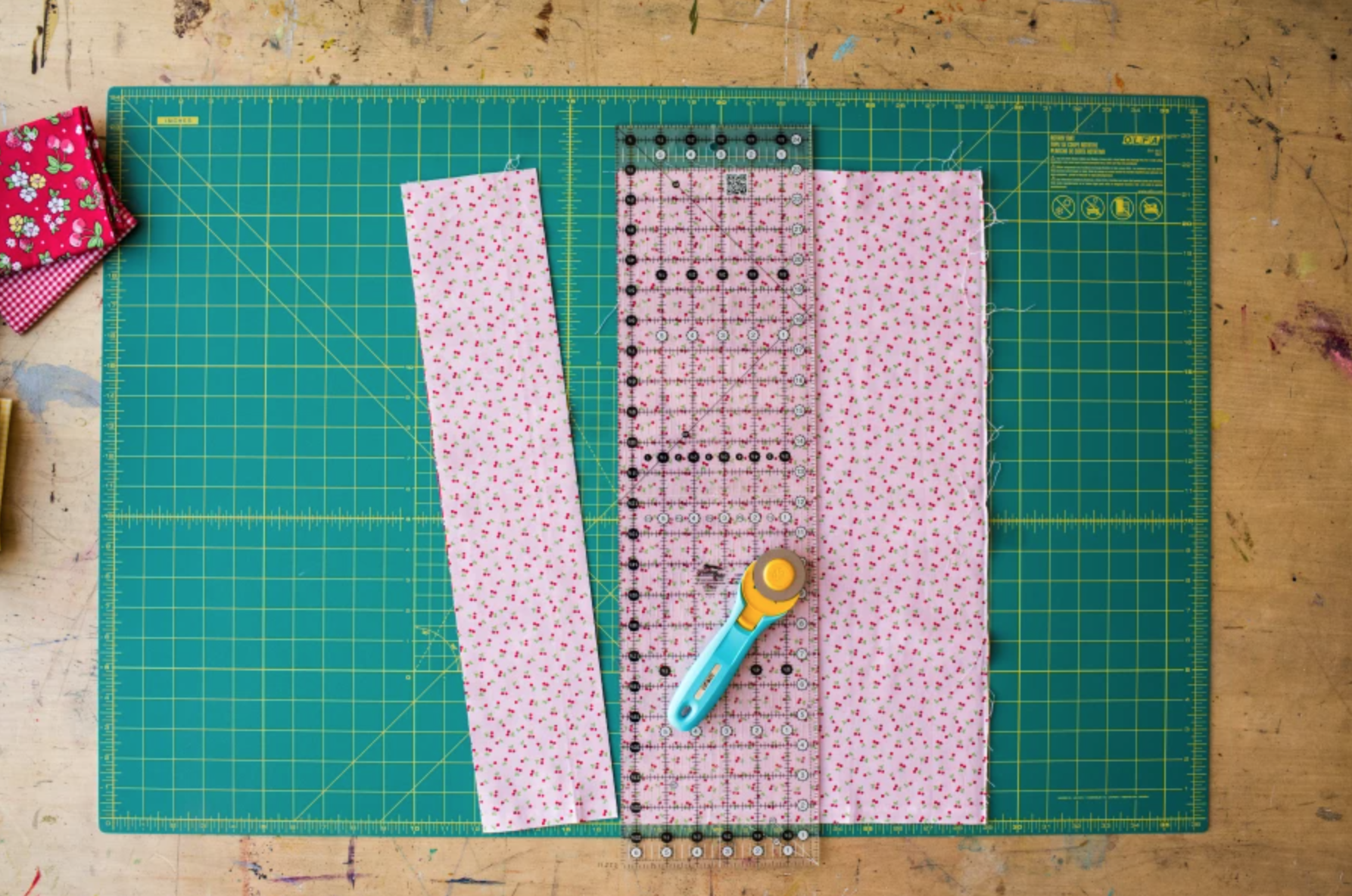 cutting mat with fabric and rotary cutter