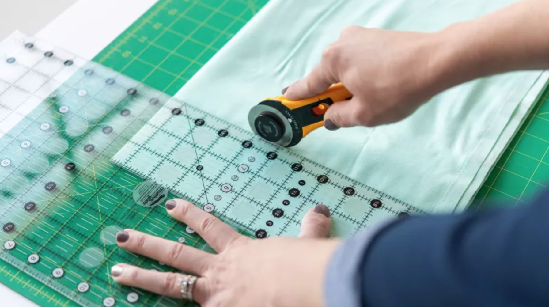 cutting fabric with ruler and rotary cutter