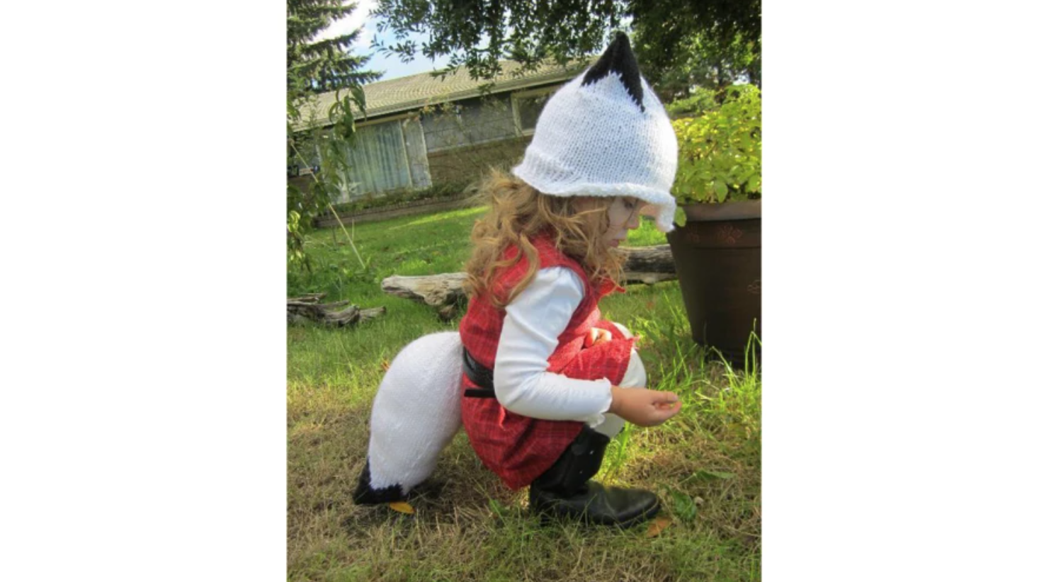 child wearing a winter fox hat and tail