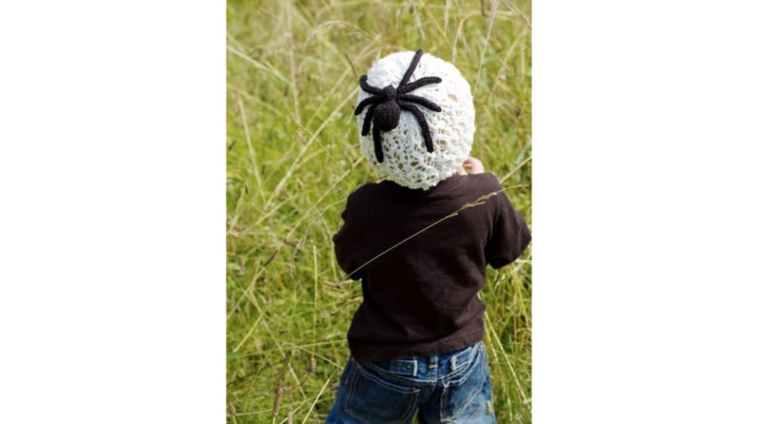 child wearing spider web hat