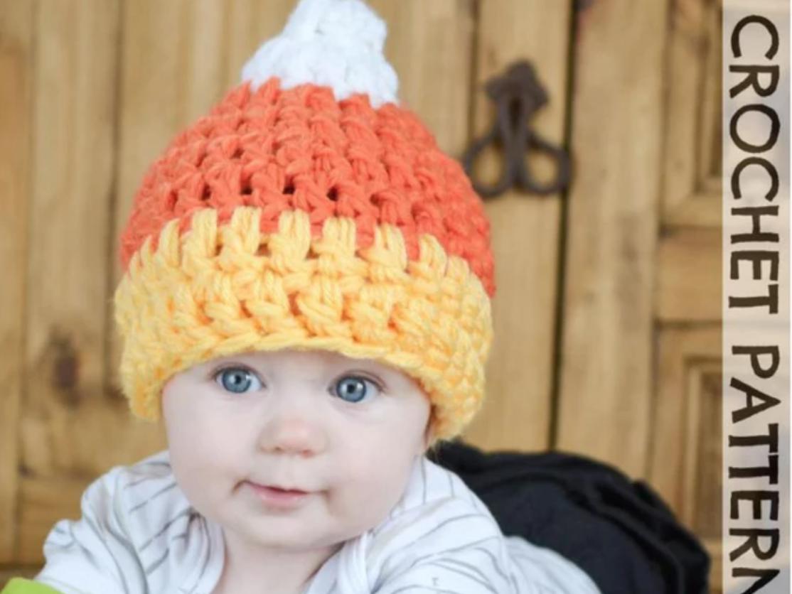 baby wearing crochet candy corn hat