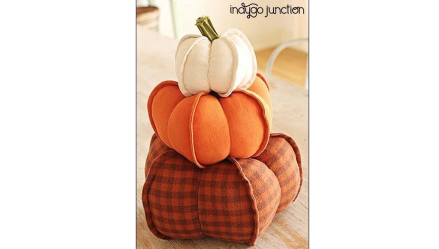 three fabric pumpkins stacked