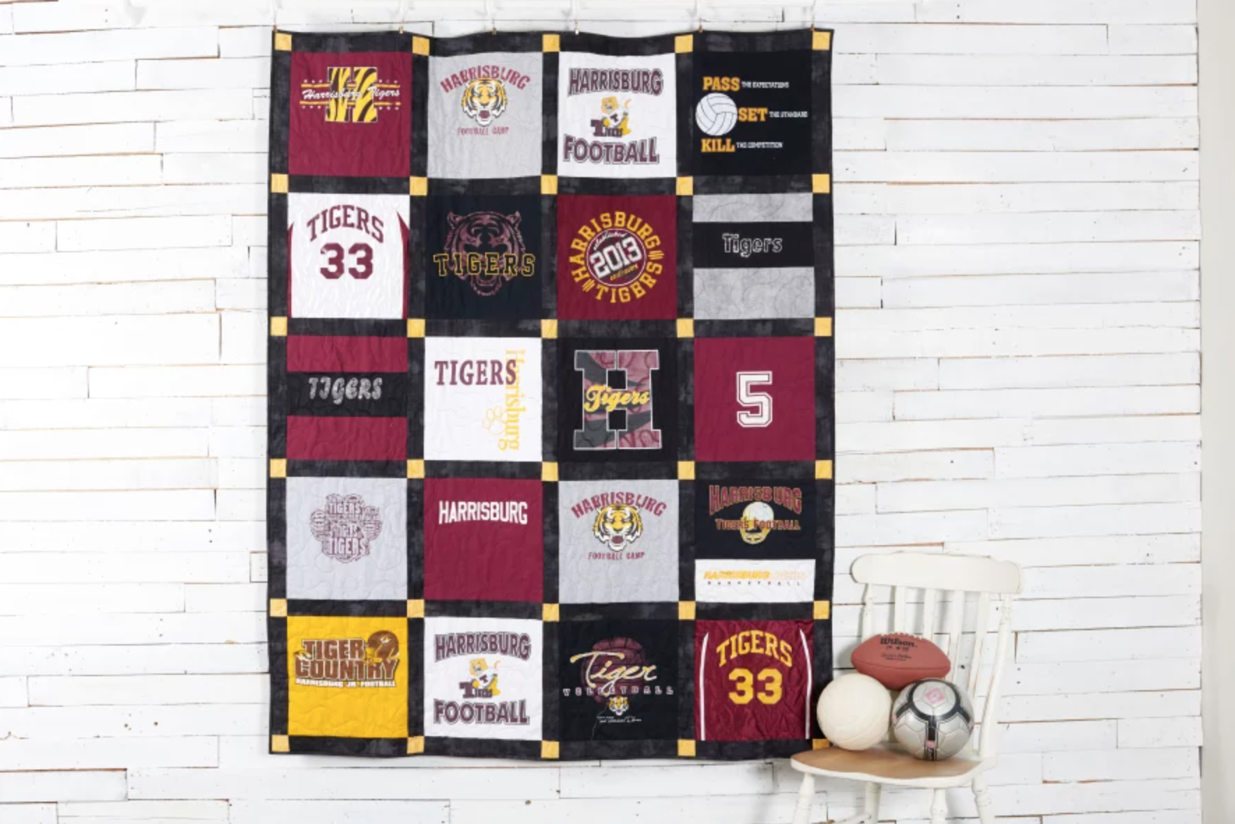 t-shirt quilt hanging on a wall