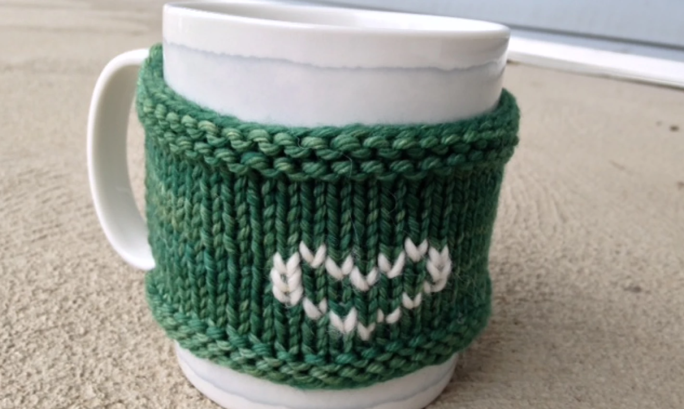 green knit mug cozy
