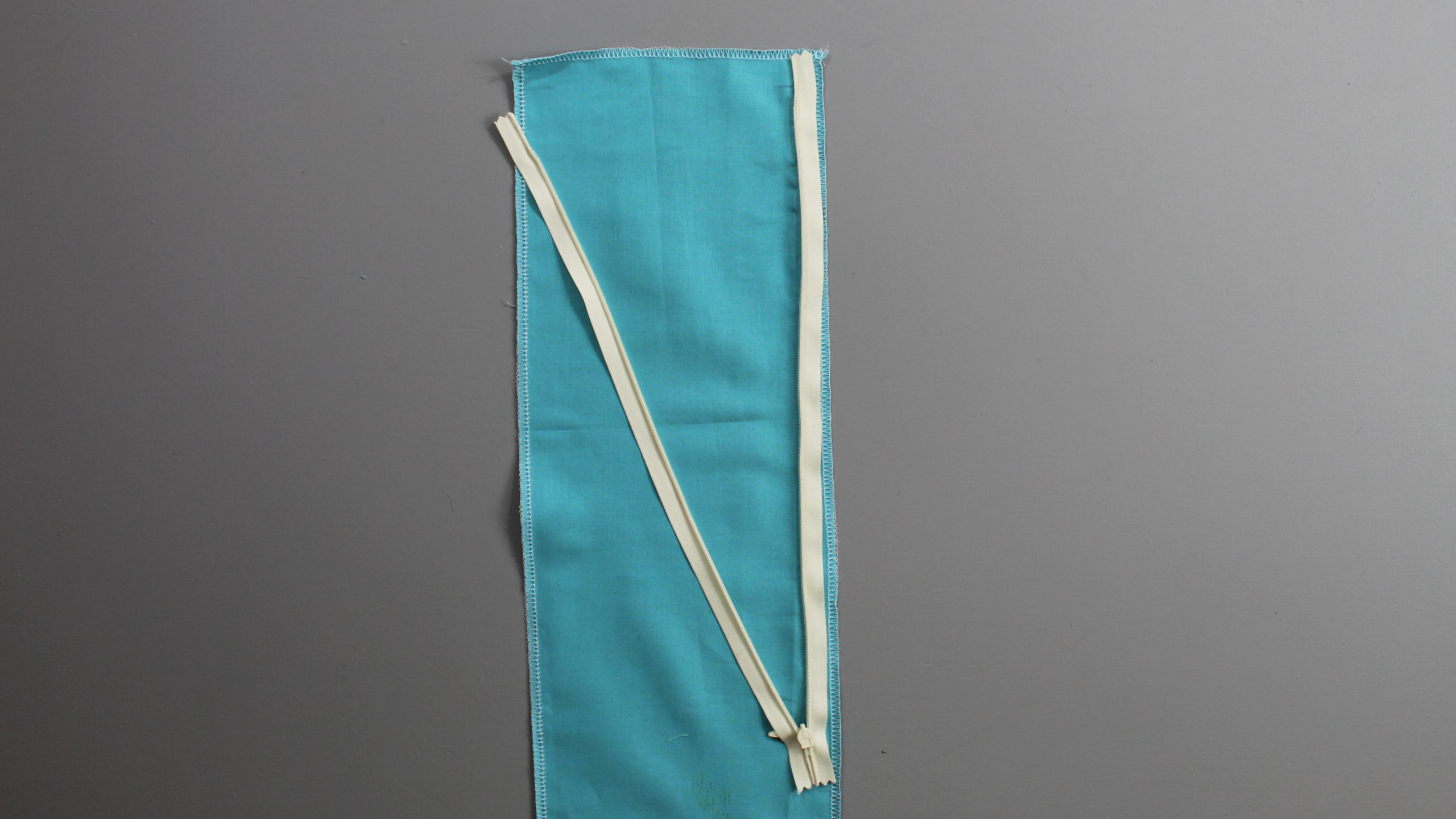 Sewed half of zipper