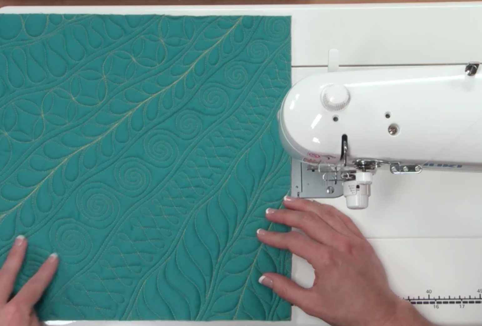 free-motion quilting teal fabric