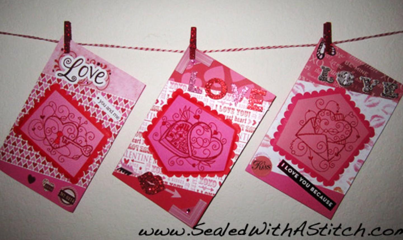 three machine embroidered valentines