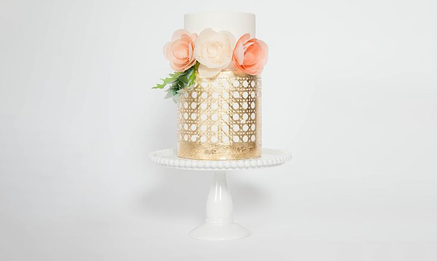 white and gold cake with wafer paper