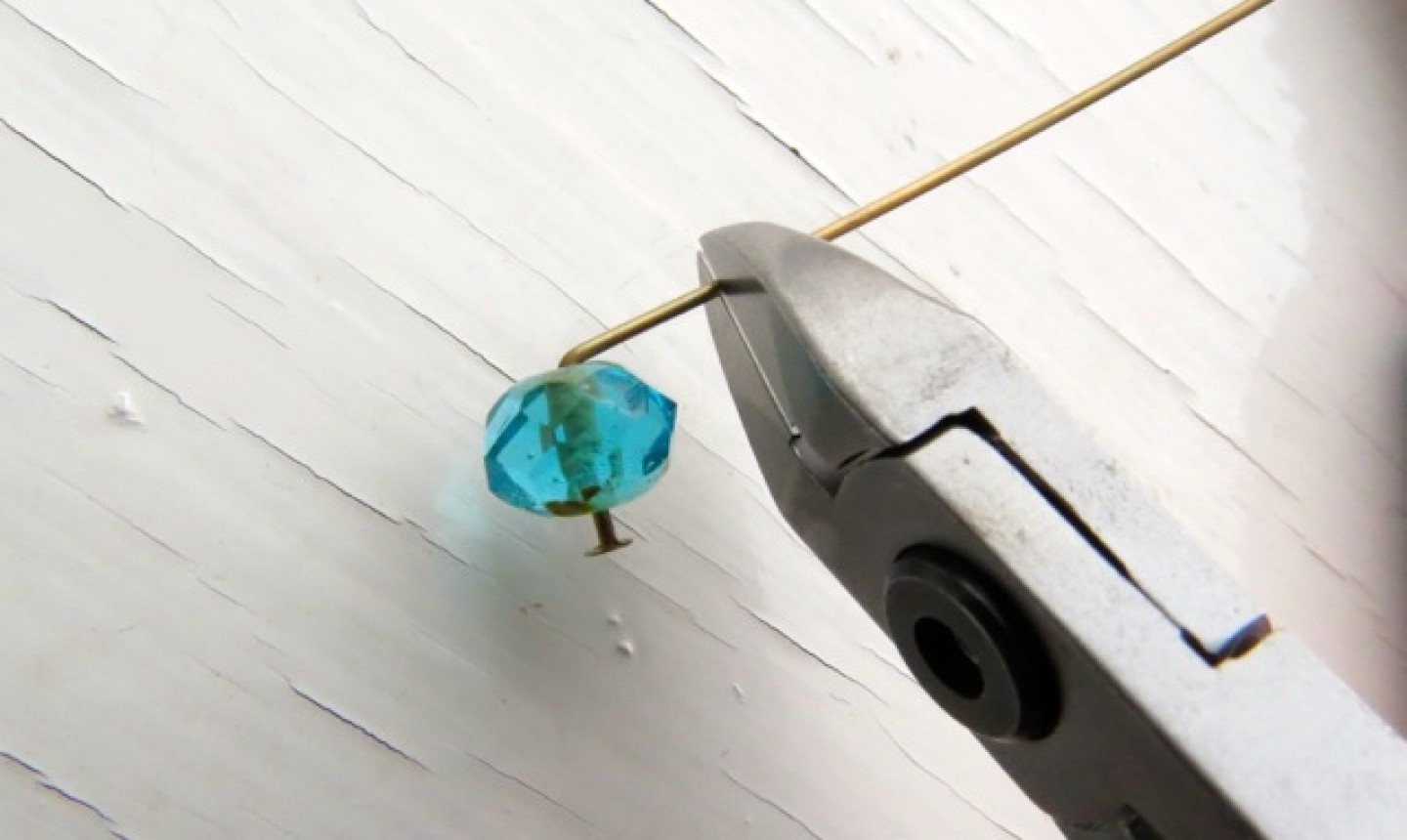 clipping wire in blue bead