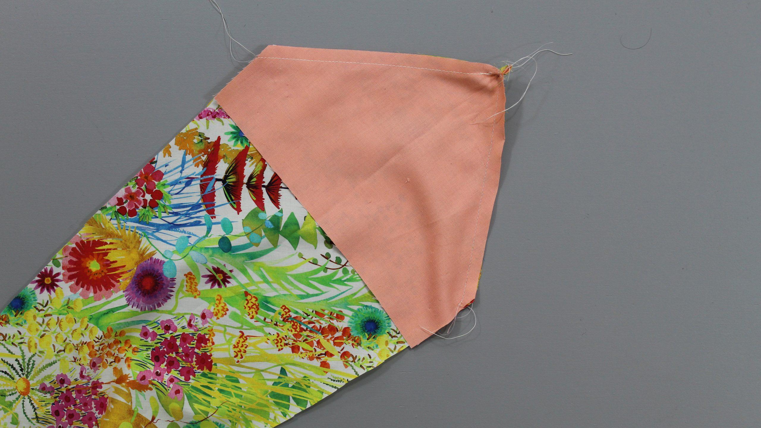 Stitch bottom of tie