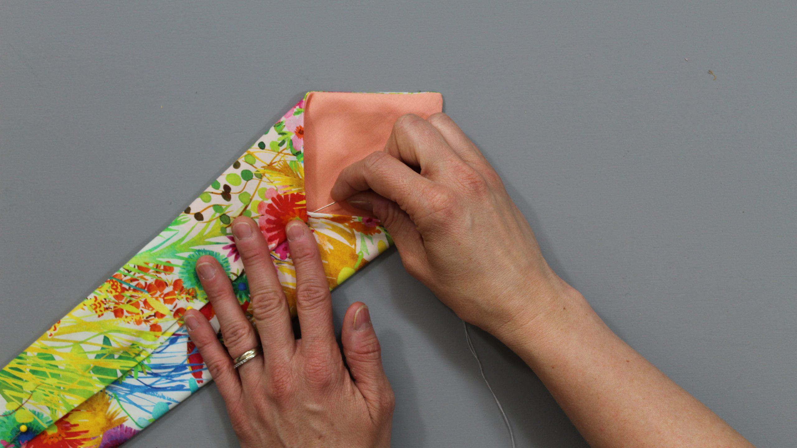 Hand stitching the fold