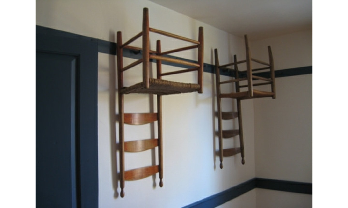 shaker chairs on a wall
